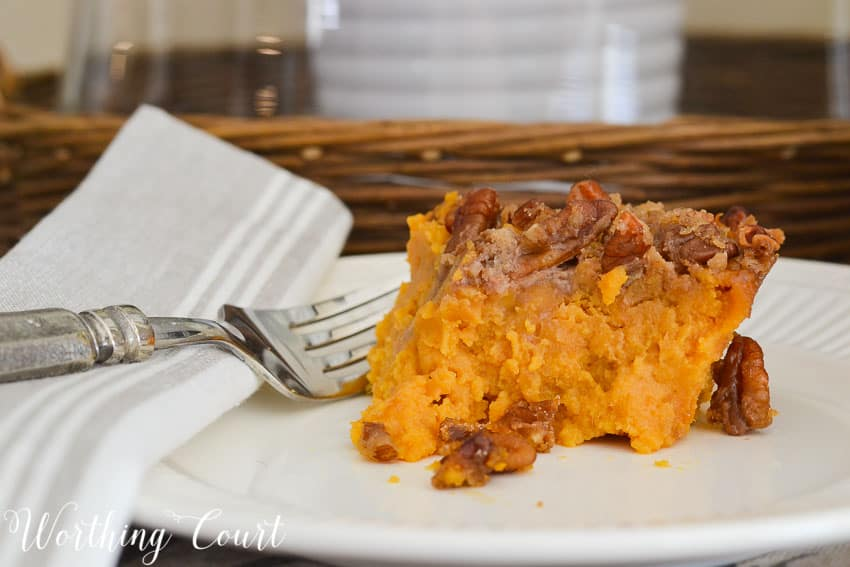 Single serving of sweet potato casserole with a fork on the plate.