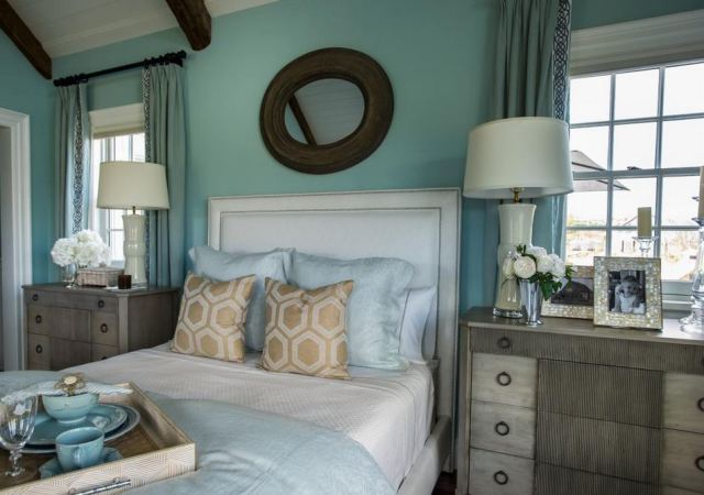 The use of taller chests gives the master bedroom a grand feel