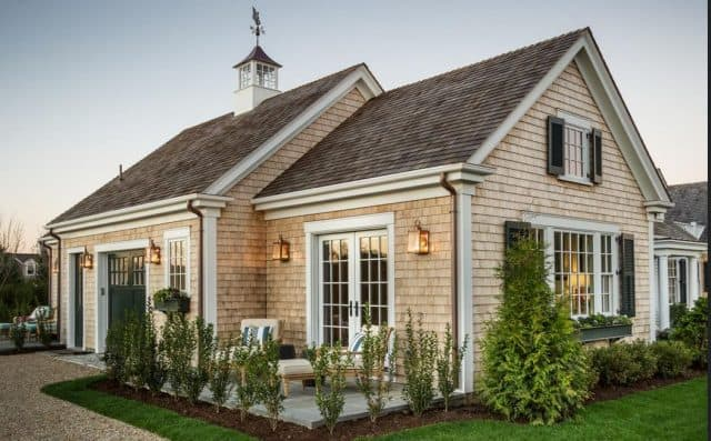 Add a cupola and pretty landscaping to an outbuilding, like a storage shed.