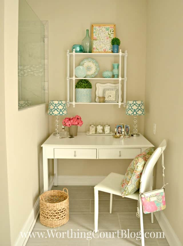 An old desk recyled into a master bathroom dressing table and makeup vanity