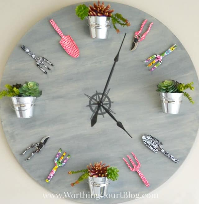 "Make a truly eye-catching piece of ""art"" with an old tabletop, some gardening tools and few other supplies.  This is an easy and fun project!  Find out all you need to know to make one for yourself at Worthing Court Blog."