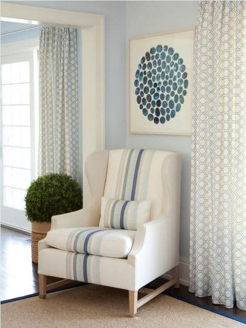 Love the stripes in the chair fabric paired with the pattern in the drapery fabric