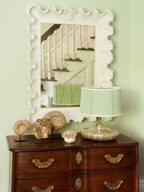 Pretty and soft mint green and current accessories give this traditional chest and updated look.