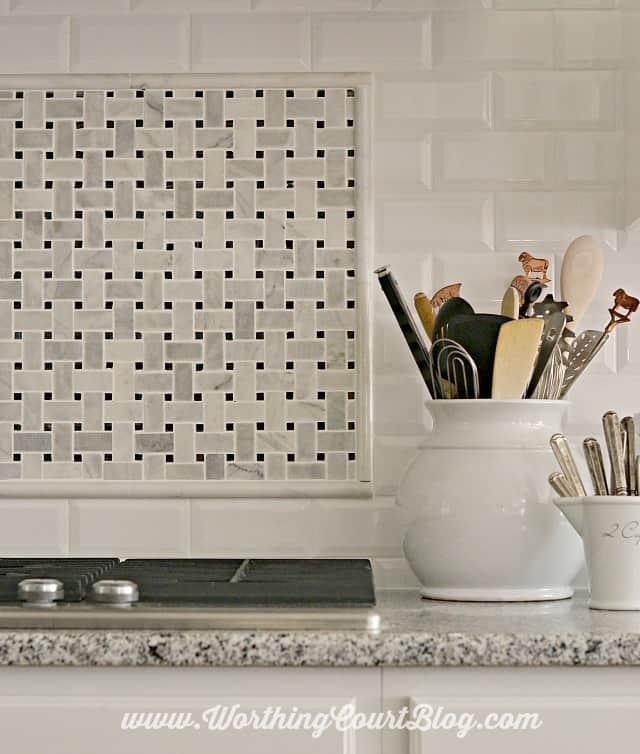 Kitchen backsplash using faceted subway tile and carrera marble