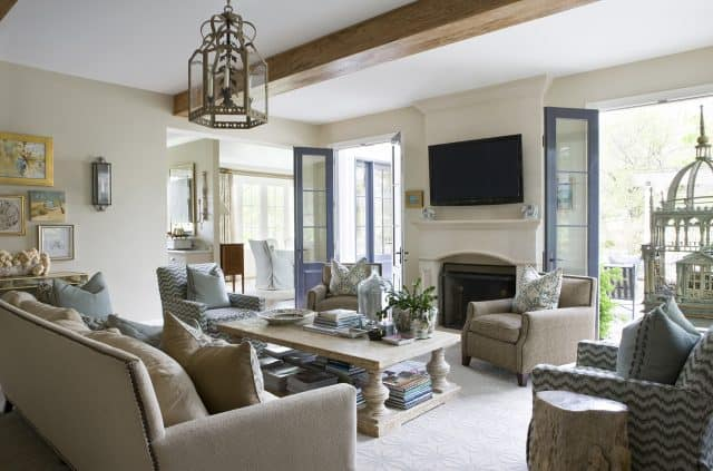 A lovely living room filled with grays and soothing blues by Ivy Lane