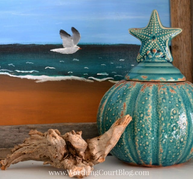 Beachy bookcase vignette
