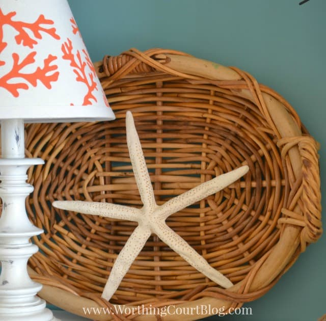 Add a starfish to a basket leaning against the back of a bookcase