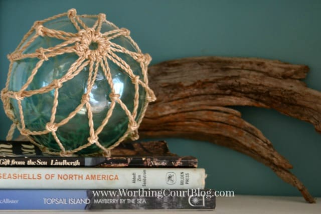 A beachy bookcase vignette