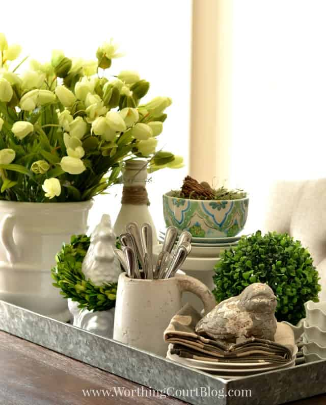 A galvanized steel tray filled with spring items.