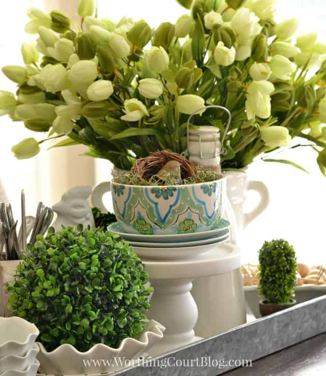 Spring Kitchen Centerpiece In A Galvanized Steel Tray on the table.