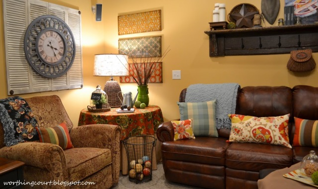 Basement family room decor.  Mixing pattern and colors and using what you already have.