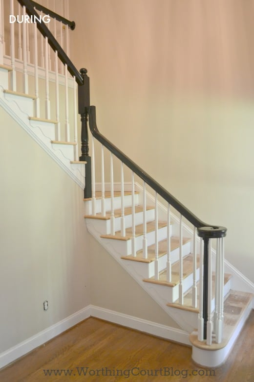 Formerly oak handrail painted black and oak trim painted white
