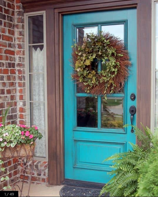 Love the wonderful shade of blue this door is painted. And the antiquing over the paint gives it a vintage vibe.