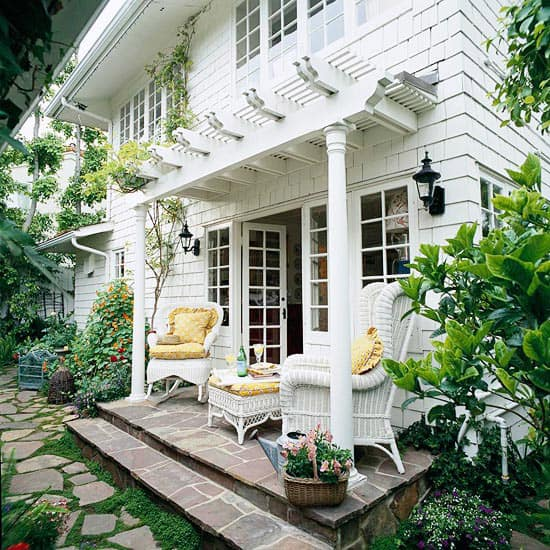 Add a pergola above a front door for architectural interest. DIY kits are readily available at big box home improvement stores.