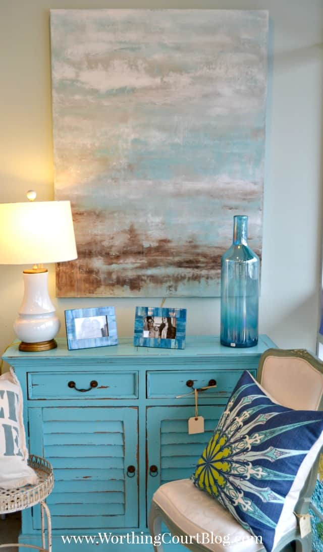 Pretty distressed blue chest with shutter doors and abstract ocean artwork
