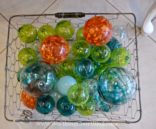 A basket filled with colorful glass fishing floats