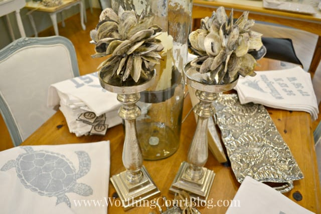 Oyster shell orbs displayed on candle sticks