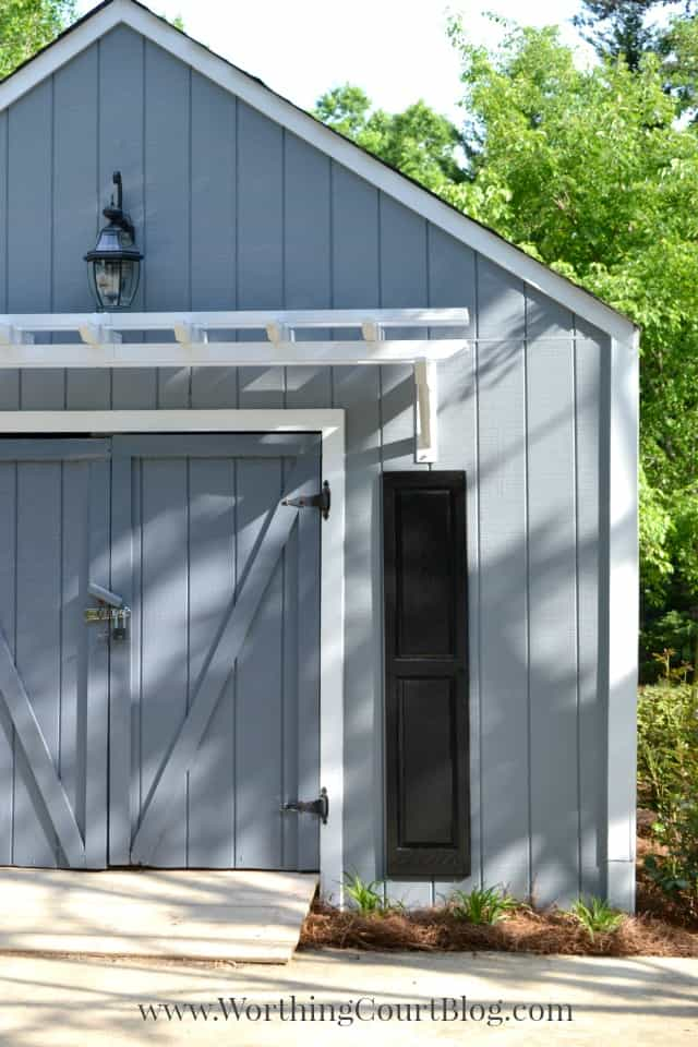 Painted shed with a pergola attached to the front