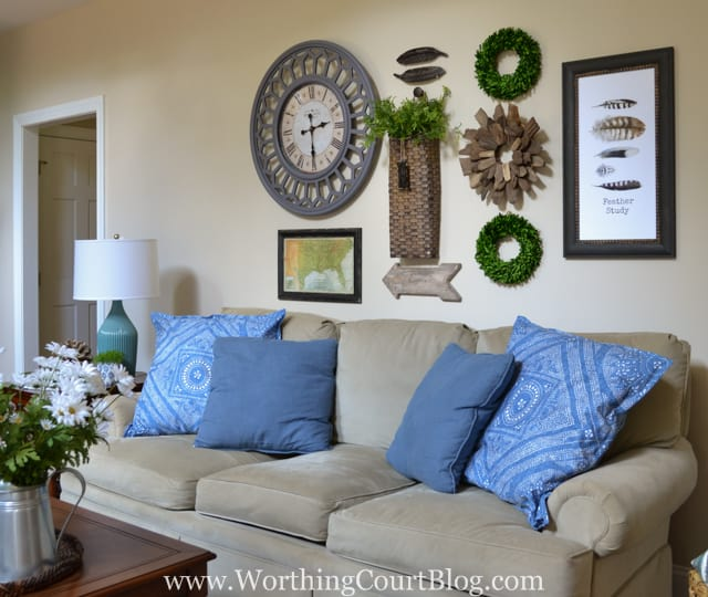 Great Gallery wall above a sofa with rustic farmhouse touches