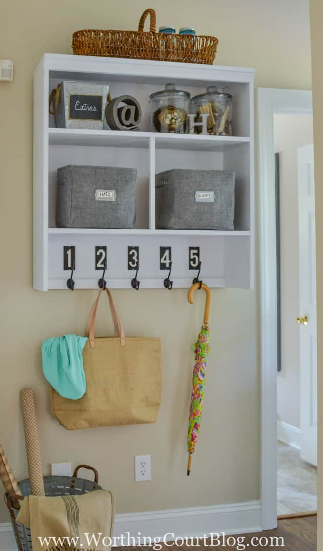 No mudroom? No problem. Repurpose the top of an old hutch into a dropzone.