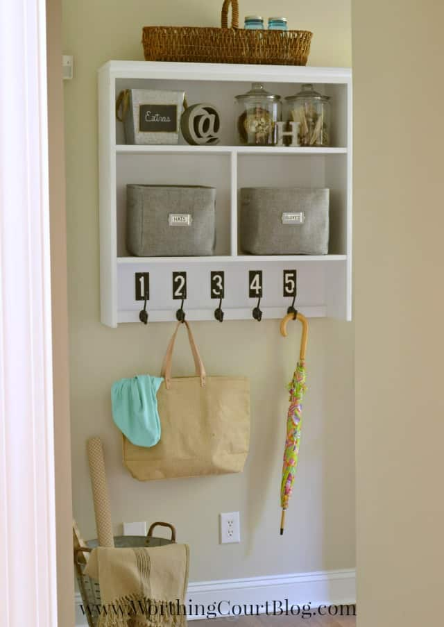 Old hutch repurposed into a mudroom dropzone