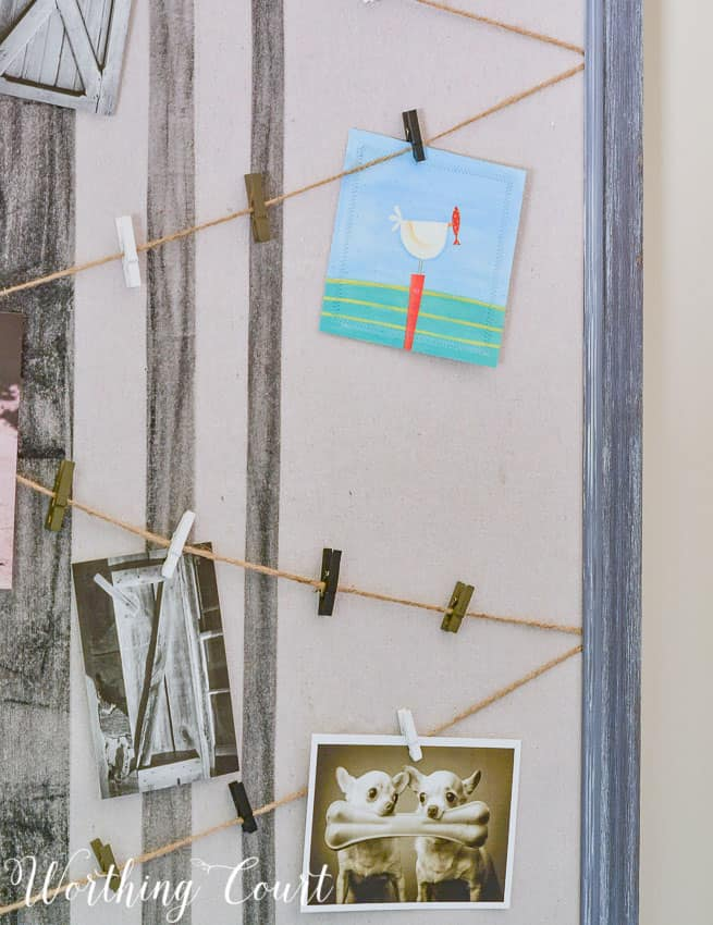 Run twine across a bulletin board and use cute clothespins to display small cards and pictures