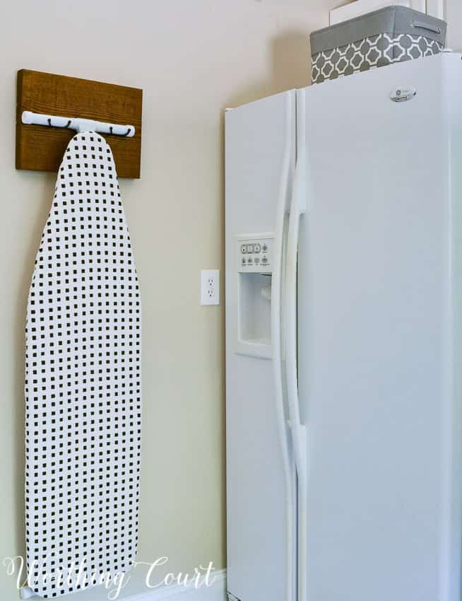 DIY ironing board hanger for the laundry room || Worthing Court