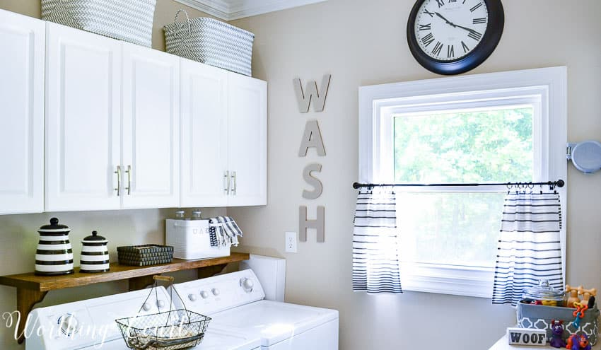 DIY shelf behind washer and dryer to hold laundry supplies || Worthing Court