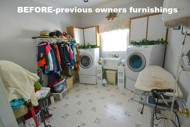 Laundry room BEFORE with previous owner's belongings