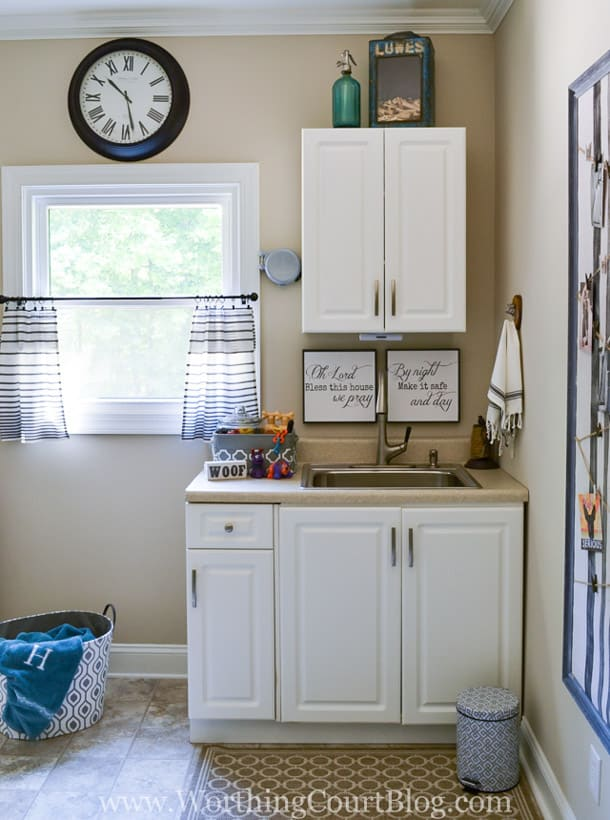 laundry room sink area with white cabinets