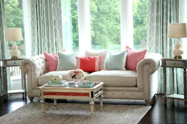 Neutral sofa with subdued pops of color by Colordrunk Designs