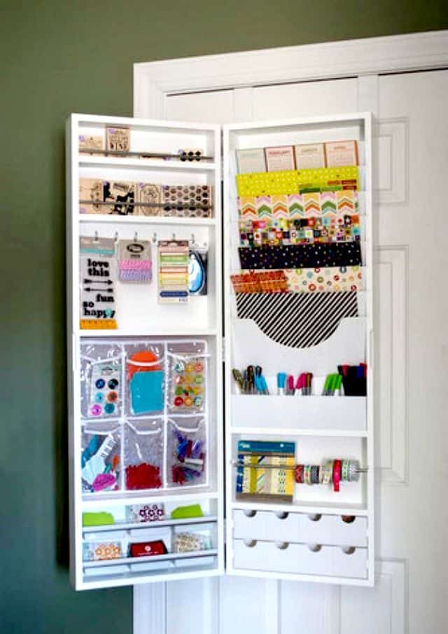Use an over the door hanging armoire to store craft and scrapbook supplies