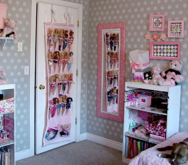 Use a hanging shoe bag on a closet door to hold Barbie dolls and their accessories