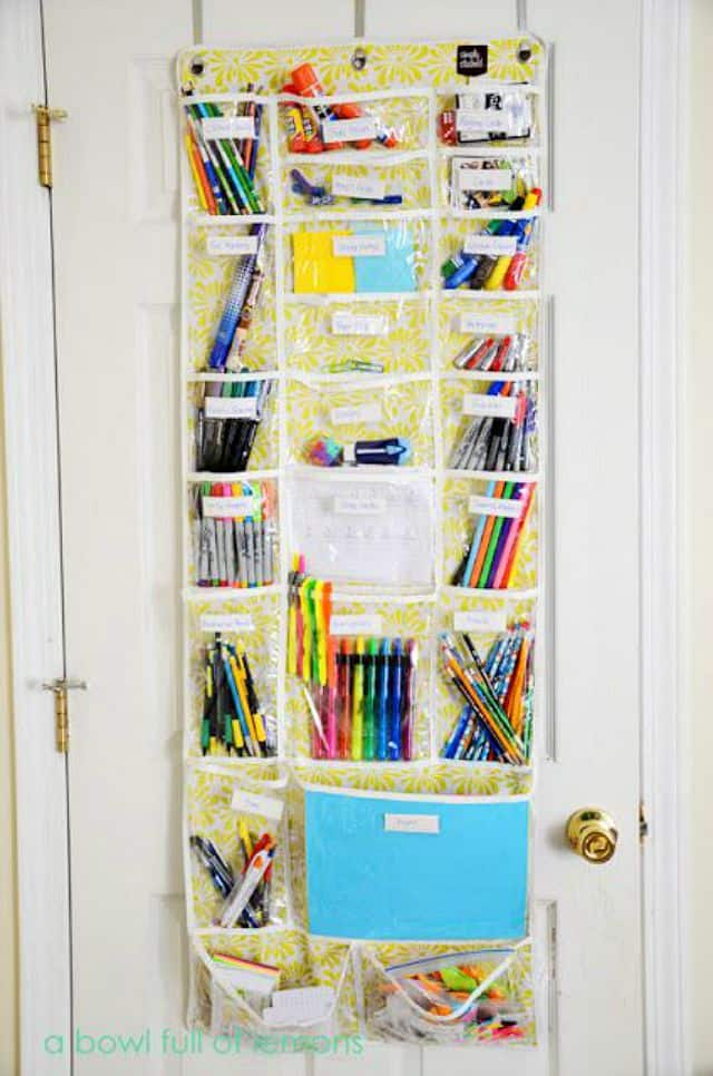 Hang a shoe bag on the inside of a closet door to hold school and art supplies