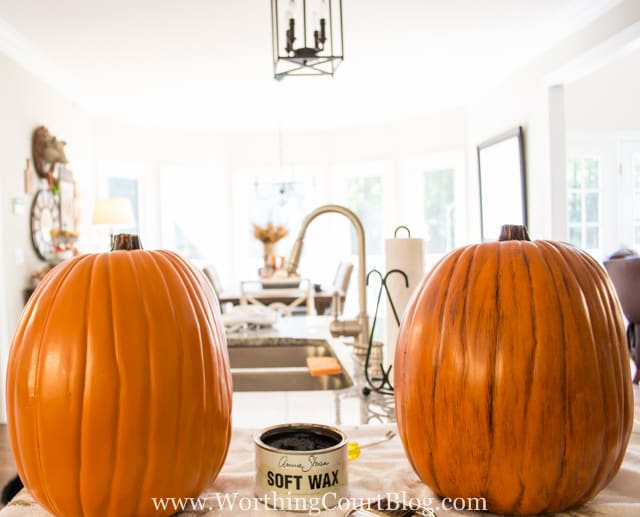 Before and after of bright orange pumpkin with dark stain applied and wiped off to achieve the desired color
