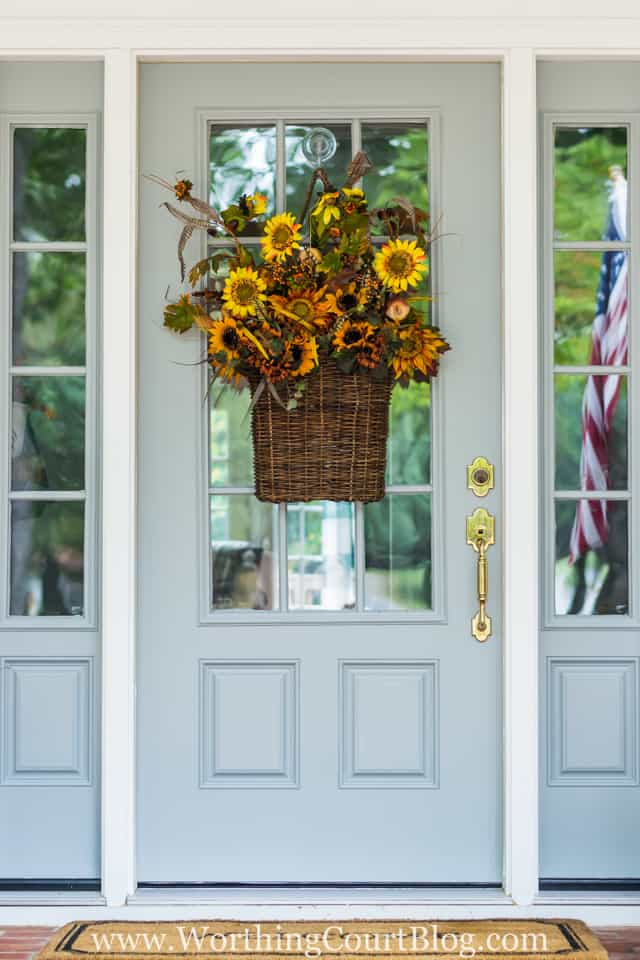 Super easy to do fall front door hanging basket filled with floral bushes
