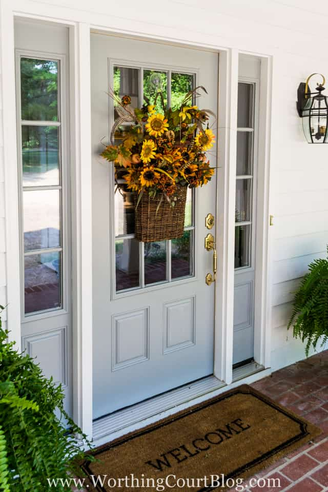 Front door and sidelights painted Sherwin Williams Network Gray