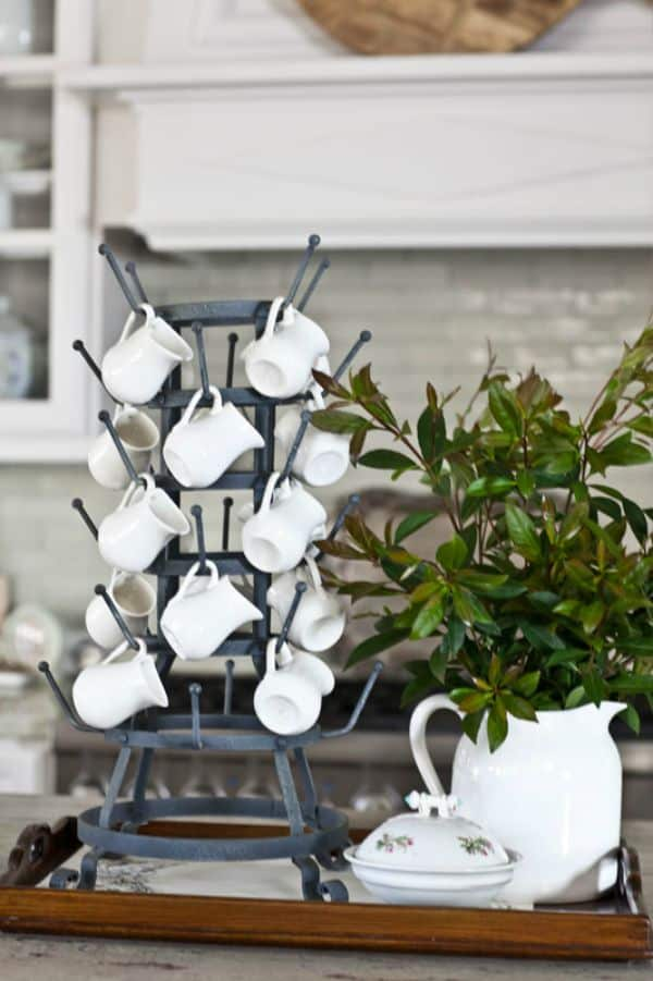 Cream pitchers displayed on a mug rack