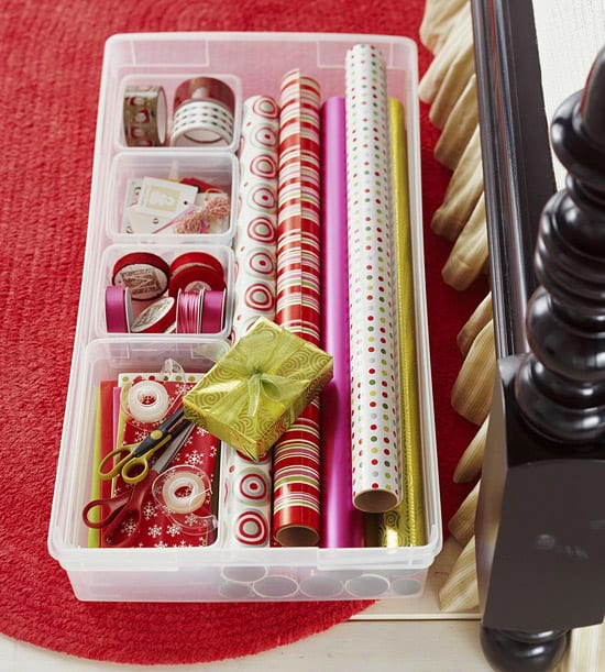 Large plastic containers with low sides are great for storing wrapping paper supplies and will slide right under a bed