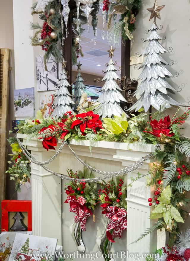 How To Decorate A Christmas Garland - Directions From A Pro with a fireplace mantel all decorated.