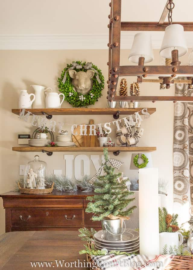 Rustic shelves in the dining room are decorated for Christmas.