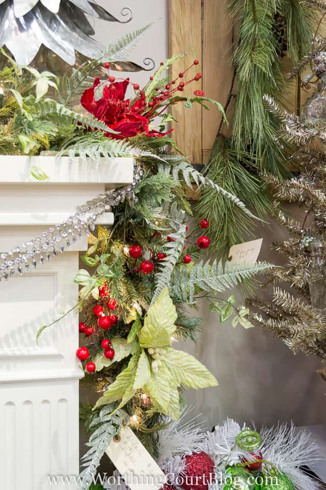 The garland trailing down the side of the mantel.