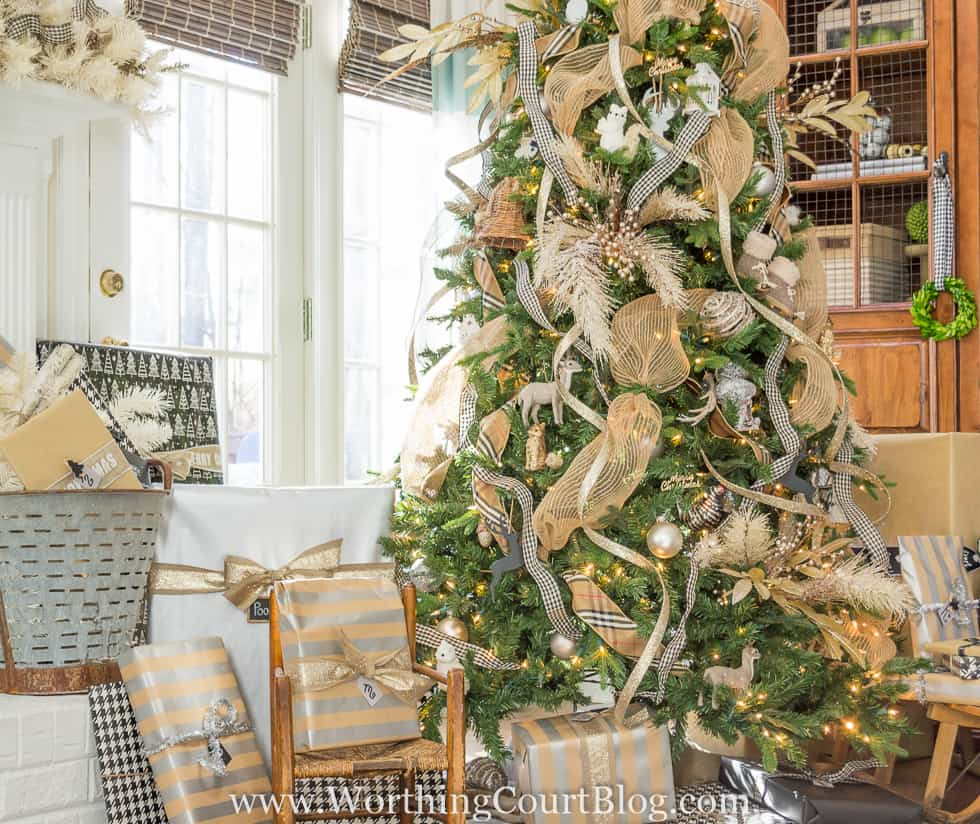 Rustic luxe Christmas tree with a variety of ribbons and ornaments.