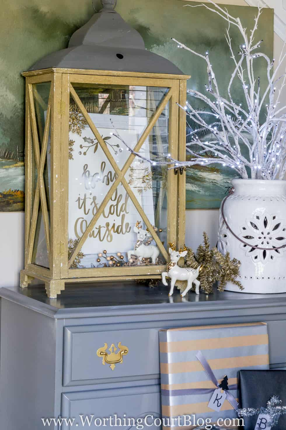 A rustic lantern with the print inside it.