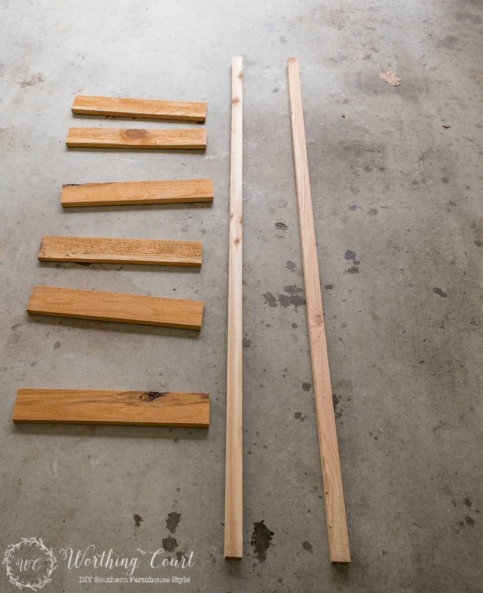 Pieces of wood laid out on the floor to make the ladder.