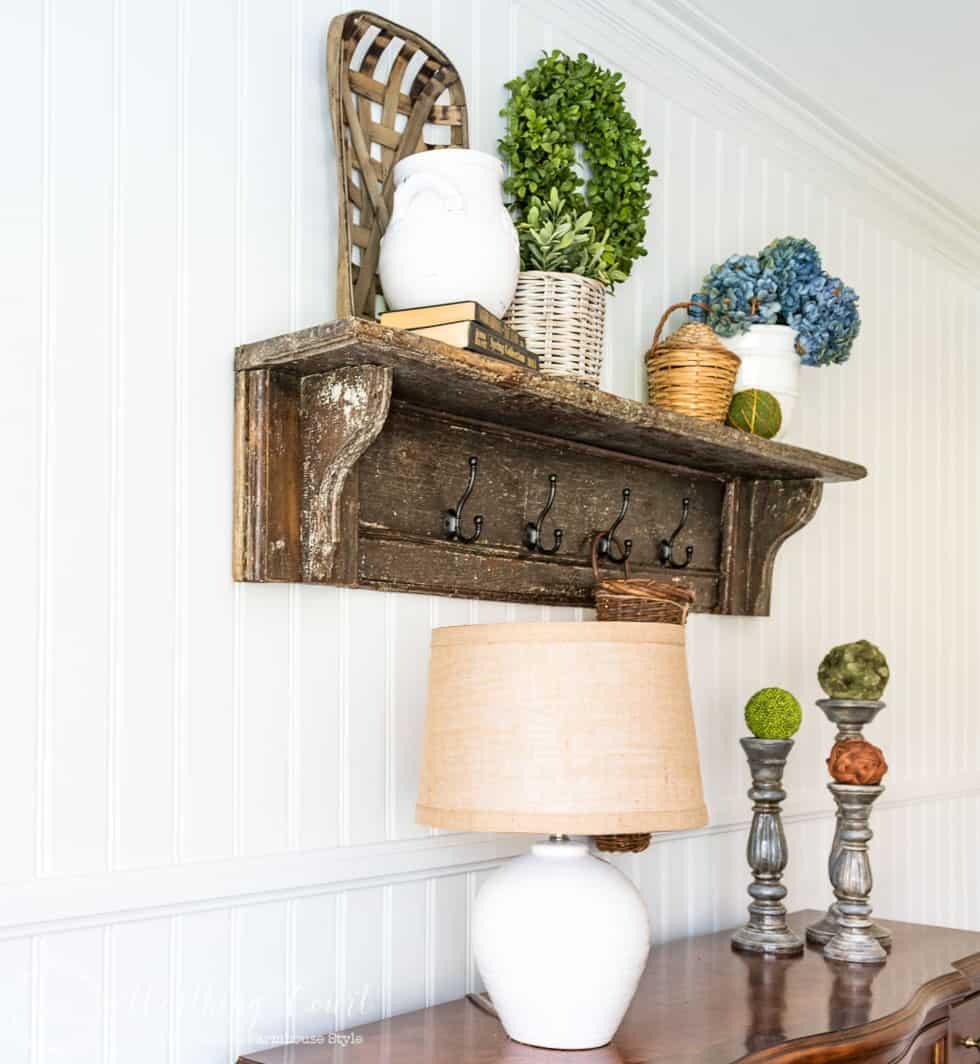 A wooden shelf on the shiplap wall.