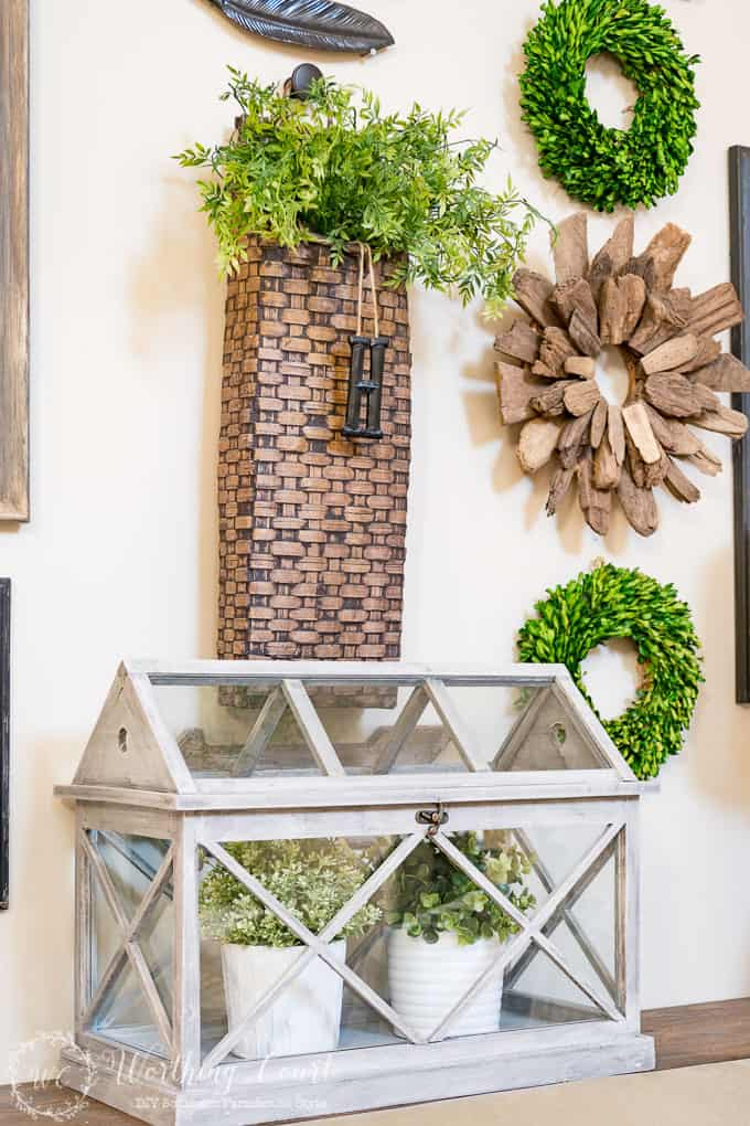 Fill a terrarium with faux greenery for easy spring decorating