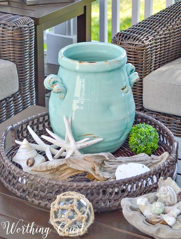 Aqua vase on round tray with starfish
