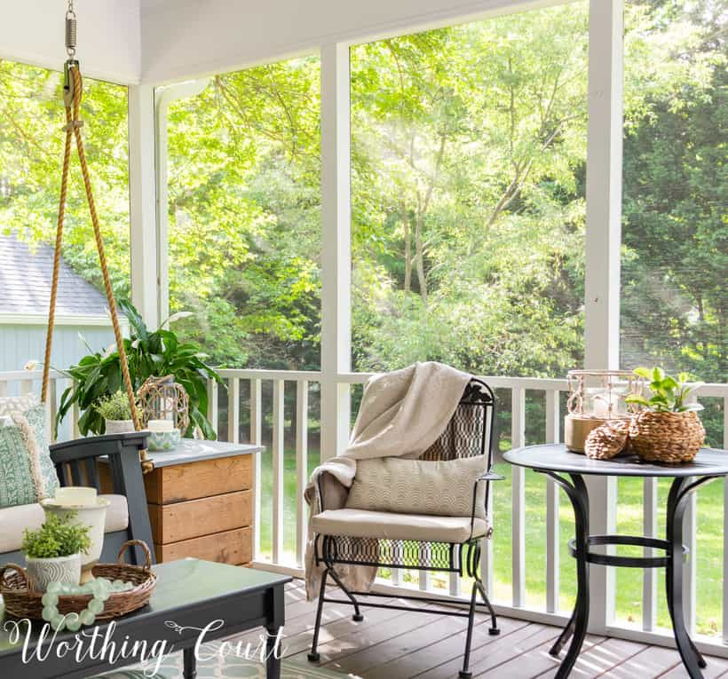 Screen porch with wrought iron furniture