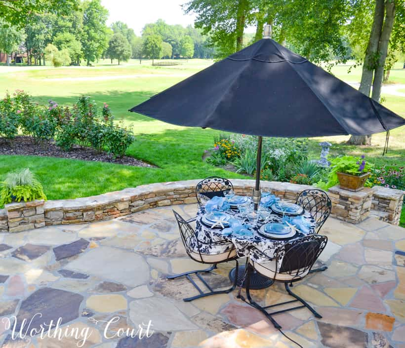 patio with dining table overlooking yard